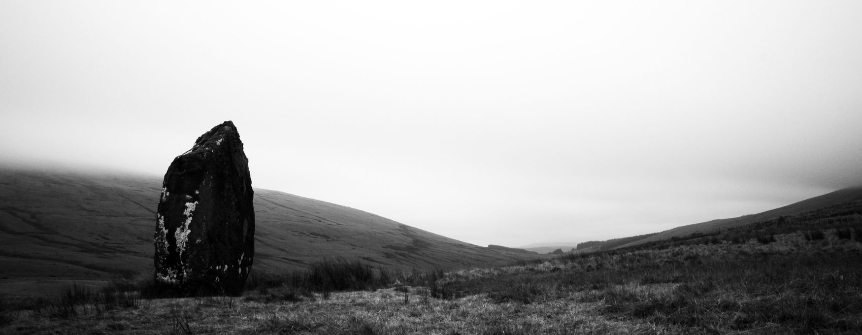 The ancient standing stone known as Maen Llia. Black & White Ancient Wales