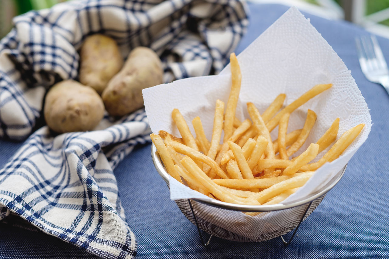 Close-up Day Deep Fried  Fast Food Food Food And Drink French Fries Freshness Indoors  One Person People Prepared Potato Ready-to-eat Real People Unhealthy Eating