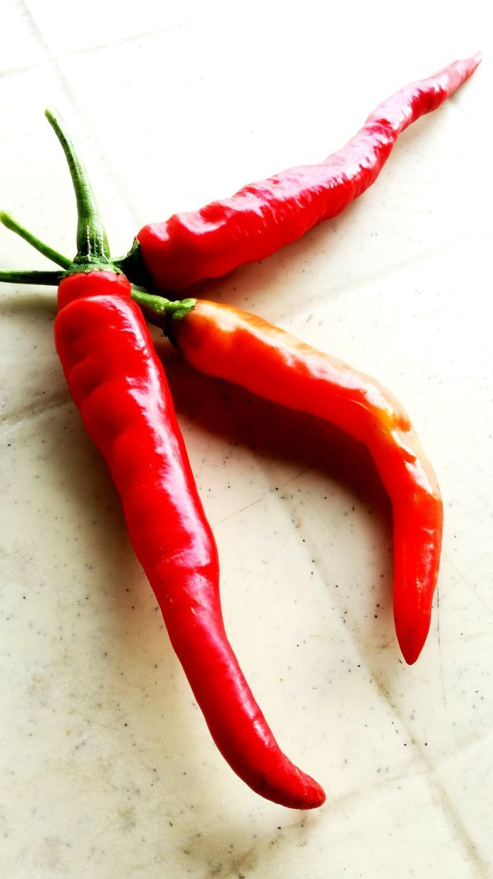 red, food and drink, spice, food, vegetable, ingredient, healthy eating, freshness, no people, green chili pepper, high angle view, close-up, red bell pepper, indoors, day