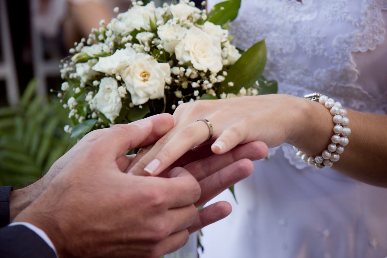 Ceremony Close-up Couple Cropped Flower Focus On Foreground Fragility Gold Hand Hands Holding Human Finger Leisure Activity Lifestyles Marriage  Outdoors Part Of Person Petal Ring Rings Touching Unrecognizable Person Wedding Wedding Photography