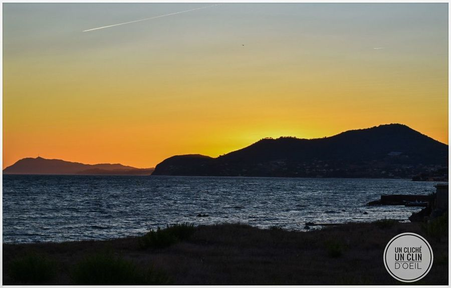 Sunset Mountain Scenics Tranquility Sky Beauty In Nature No People Sea Nature Landscape Water Outdoors Astrology Sign Tree Day Astronomy Hyères France🇫🇷 Unclicheunclindoeil Paint The Town Yellow