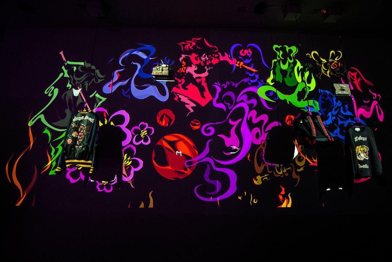 tribal GUCCI Illuminated Night Multi Colored Lighting Equipment Neon Black Background GUCCI Outdoors