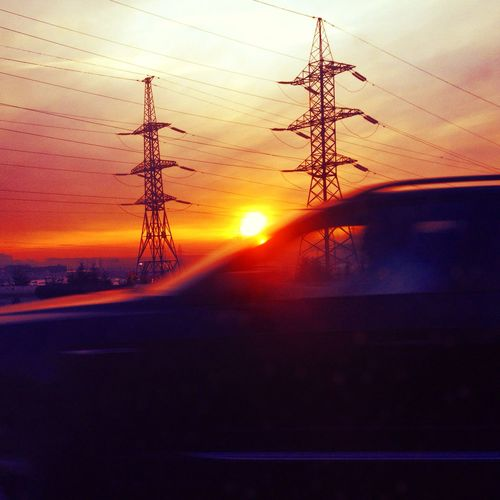 Away Cable Electricity  Electricity Pylon Moving Car No People Orange Color Outdoors Power Cable Power Line  Silhouette Of A Car Sun Sunbeam Sunset