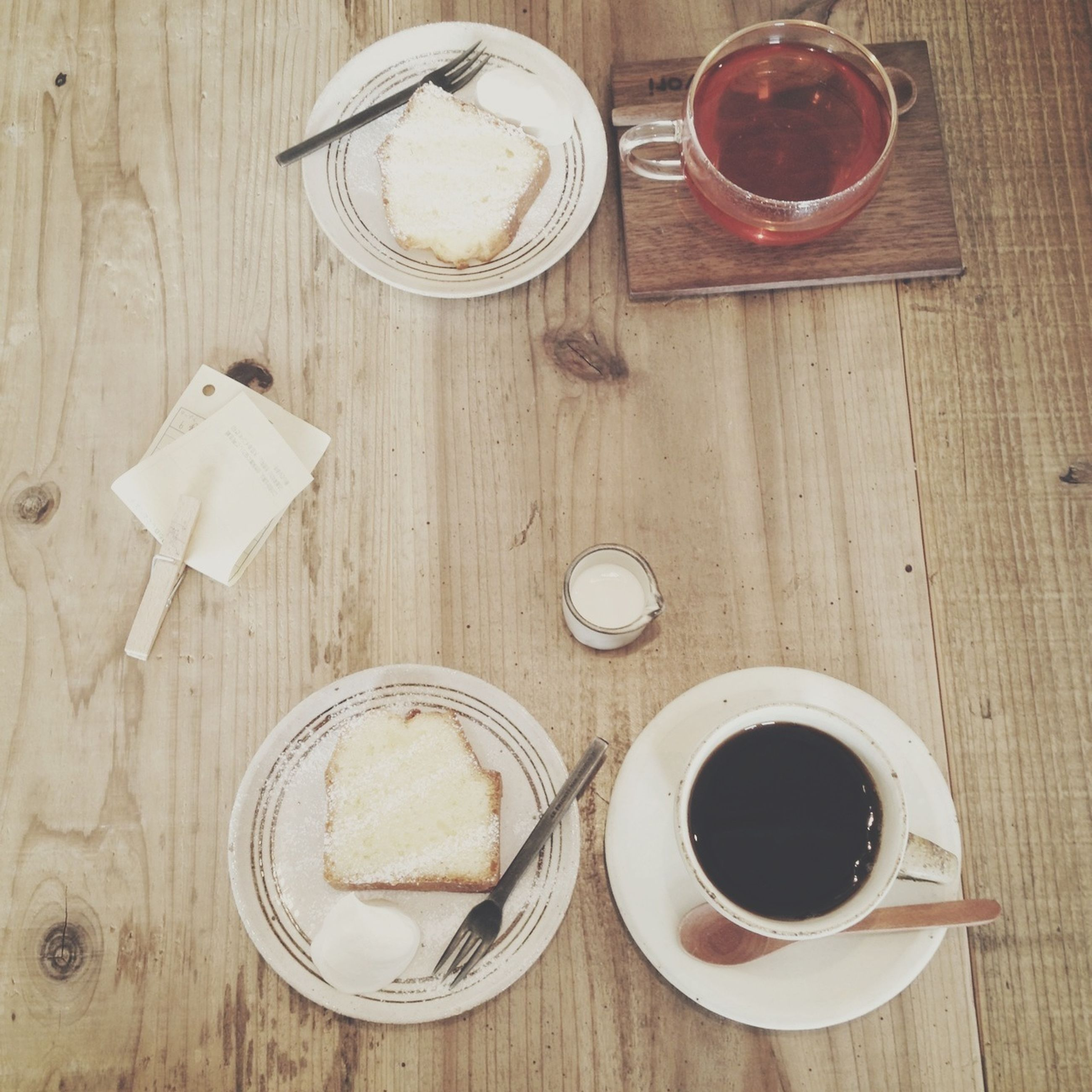 drink, food and drink, table, refreshment, coffee cup, indoors, coffee - drink, saucer, freshness, still life, coffee, cup, spoon, high angle view, directly above, wood - material, tea cup, frothy drink, beverage, tea