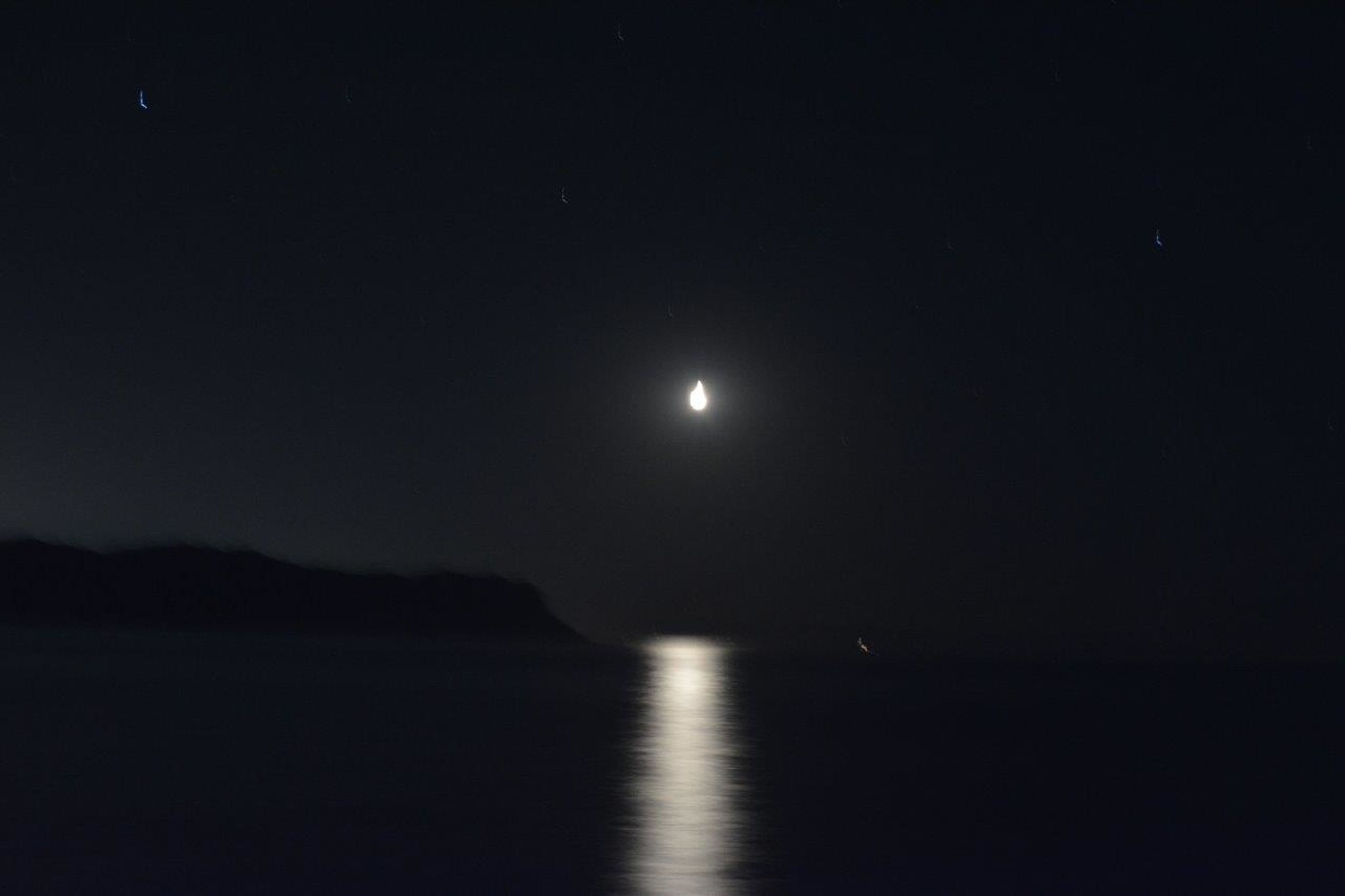 night, tranquil scene, scenics, tranquility, copy space, beauty in nature, moon, water, clear sky, nature, idyllic, dark, sky, silhouette, sea, astronomy, waterfront, illuminated, reflection, majestic