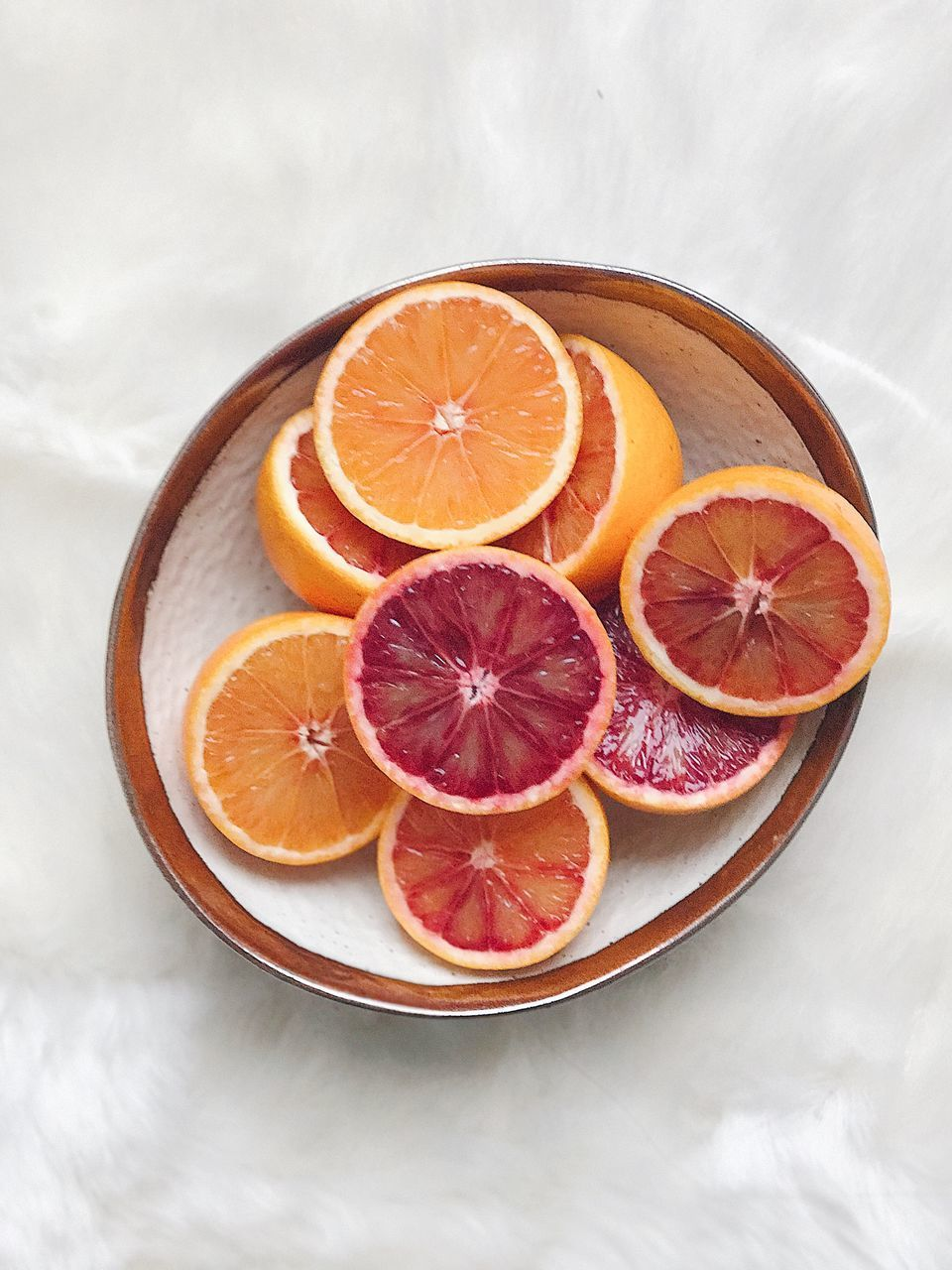 High Angle View Of Citrus Fruit Slices In Plate