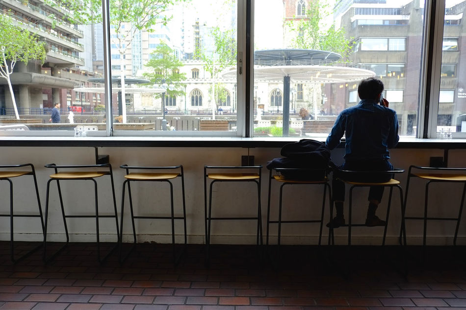 Design elements at modern-style bar/cafe/restaurant Architecture Cafe Chair Cityscape Day Full Length Indoors  Men One Person People Real People Sitting Table Tree Urban Skyline Waiting Window