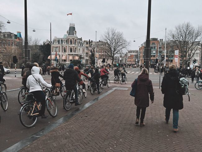 Sport In The City Sport Streetphotography Street Bikes Road Buildings People Walking  People Footpath Bricks Outdoors Amsterdam Netherlands Winter February Traveling Celebrate Your Ride
