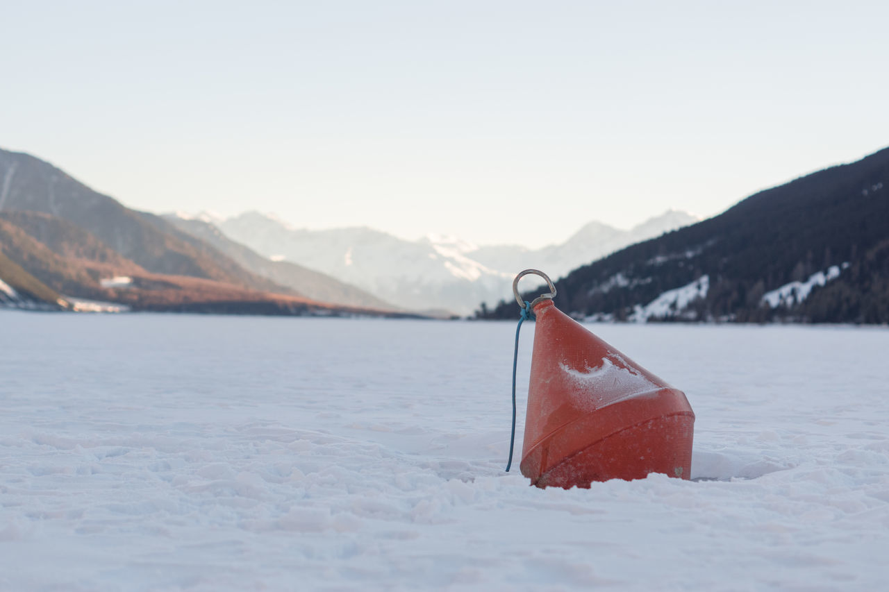 Beautiful Landscape Beauty In Nature Buoy Buoy On The Water Clear Sky Cold Temperature Day Focus On Foreground Frozen Landscape  Frozen Mountain Lake Frozen Sea Frozen Sea With Snow Landscape Mountain Mountain Range Mountains In Background Nature No People Outdoors Red Red Buoy Scenics Sky Snow Winter
