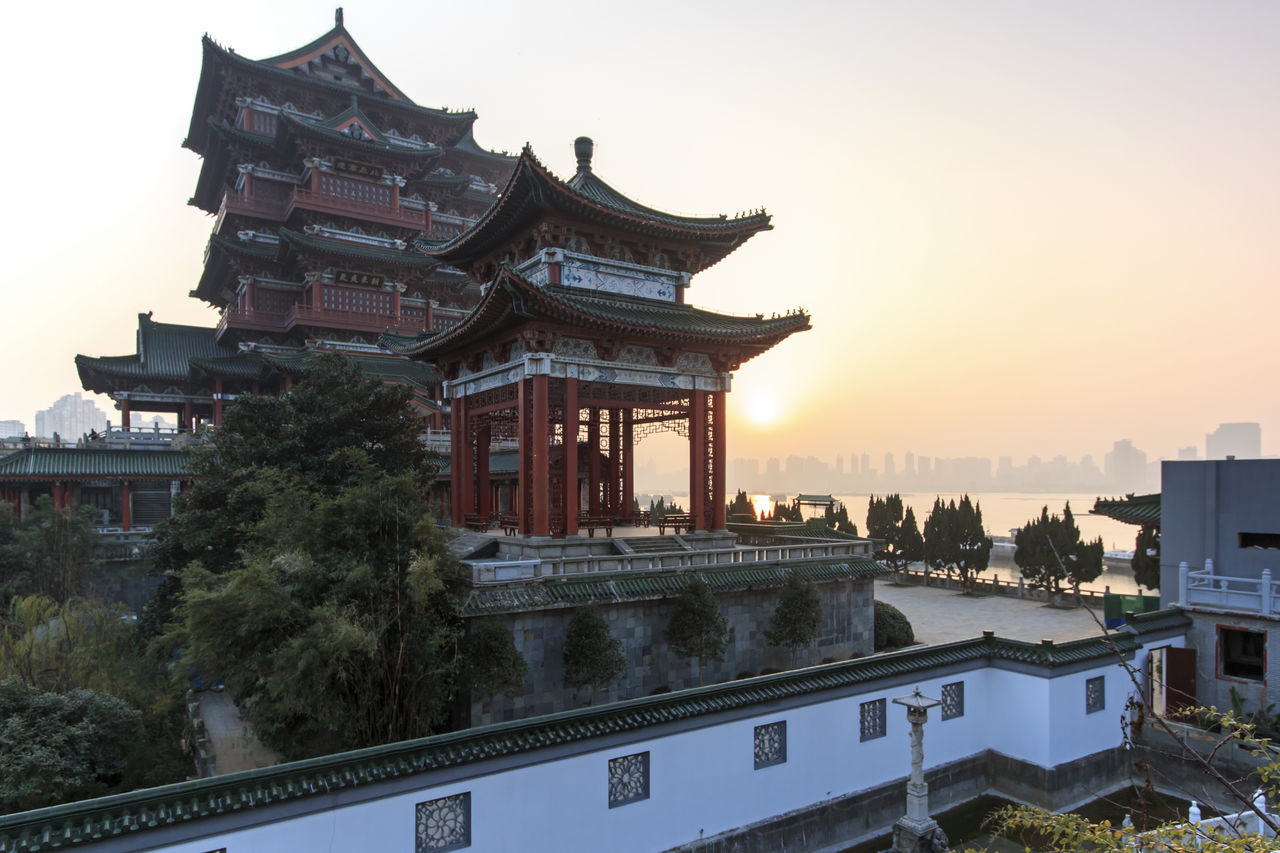 Nanchang, China - December 30, 2015: Tengwang Pavilion in Nanchang at sunset, one of the four famous towers in south China Architecture ASIA Building Exterior Built Structure Capital Cities  China Chinese New Year City Famous Place Jianxi Metropolis Modern Building Nanchang No People Outdoors Pagoda Pavilion On Lake Province Sky Sunset Tall - High Tengwang Tourism Travel Destinations Tree