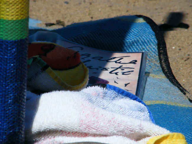 Agatha Christie Beach Beach Blanket Beach Towel Blue Close-up Fabric Holiday Holiday Reading Multi Colored Novel On The Beach Relaxing Sand Summer Reading Summertime Sunshine And Shade Textile The Essence Of Summer