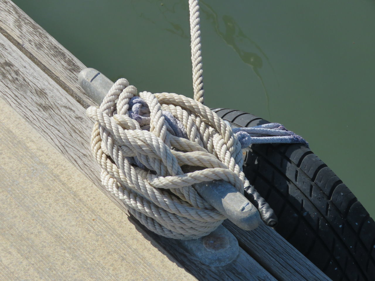 Boat Deck Check This Out Close-up Day EyeEm Best Shots High Angle View Knot Mooring Nautical Vessel No People Outdoors Pier Pulley Rigging River Riverside Rope Sailing Ship Strength Tied Tied Up Tyre Wood Pier Yacht Yachting