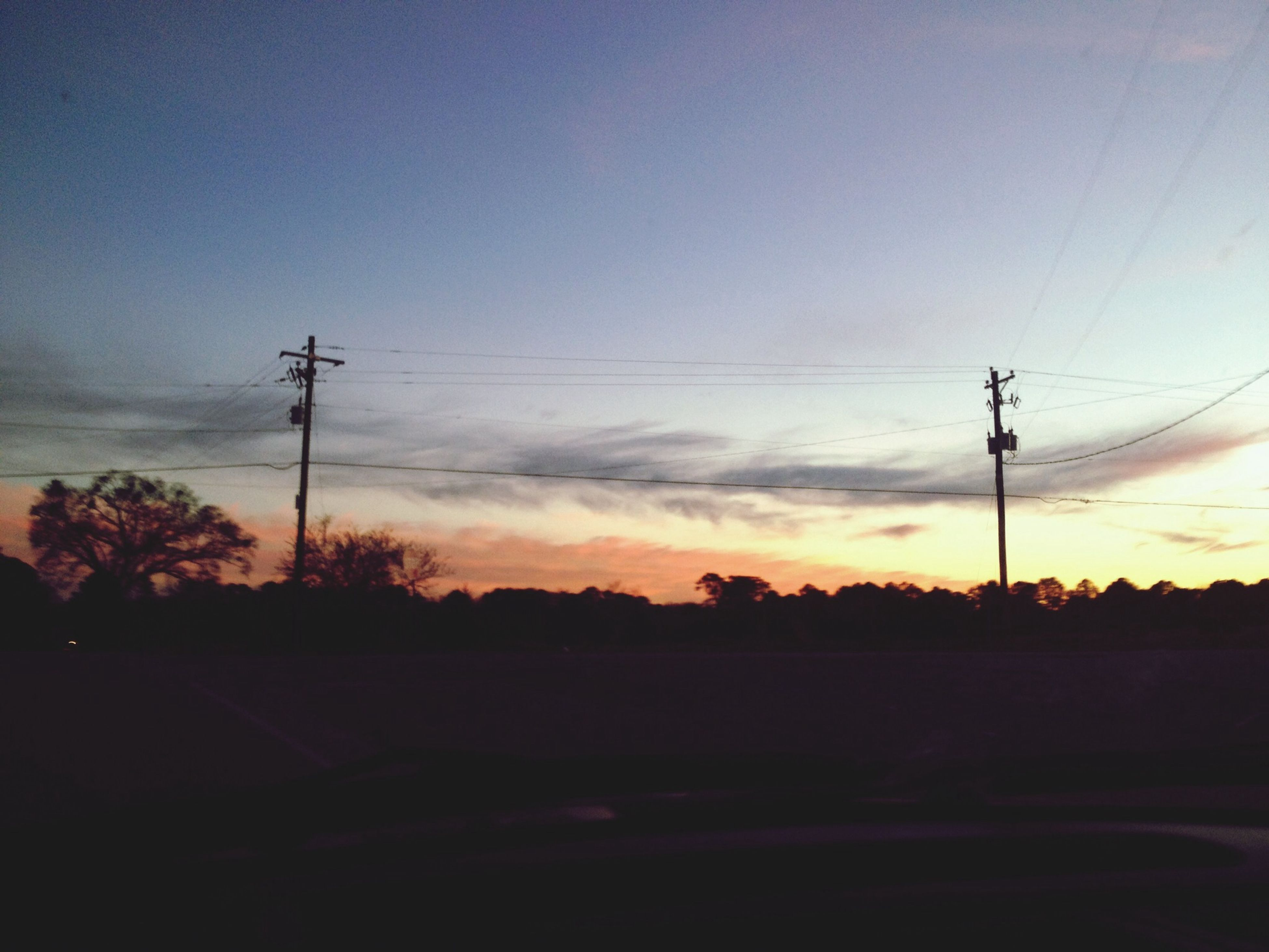 power line, electricity pylon, electricity, power supply, silhouette, sunset, cable, fuel and power generation, connection, technology, sky, tranquility, tree, power cable, tranquil scene, scenics, nature, beauty in nature, landscape, dusk