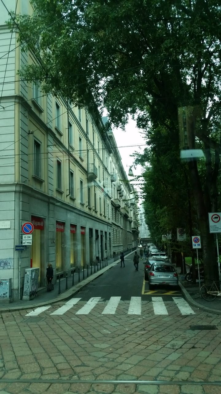 street, building exterior, architecture, tree, built structure, outdoors, day, city, sidewalk, no people