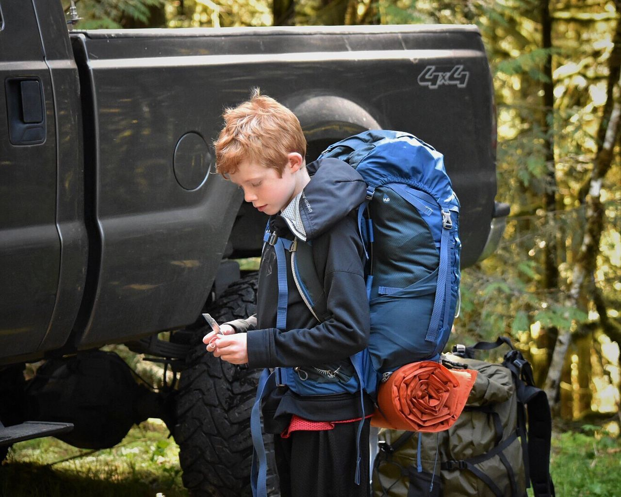 One Person Transportation Day Casual Clothing Car Standing Outdoors Communication Side View Real People Young Adult Lifestyles Blond Hair One Man Only Technology Only Men Tree People Wireless Technology Adult Backpacking Hiking Hikingadventures Backpacker Childhood