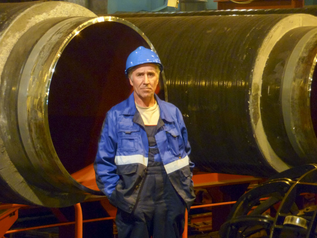 Adult Confidence  Coveralls Day Expertise Front View Hardhat  Headwear Helmet Indoors  Industry Looking At Camera Machinery Manufacturing Equipment Occupation One Man Only One Person Portrait Protective Workwear Real People Skill  Smiling Standing Wine Cask Young Adult