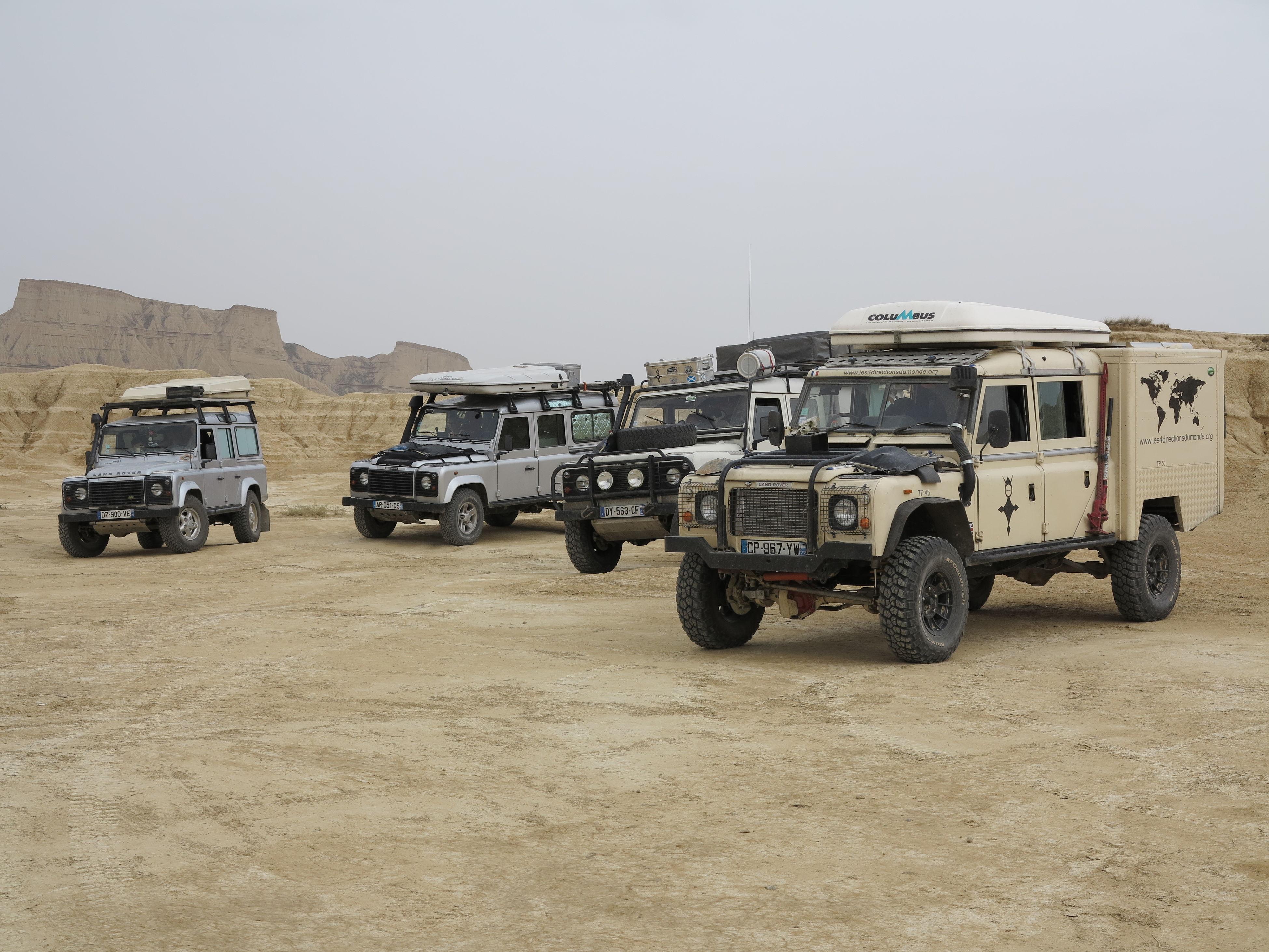 mode of transport, transportation, land vehicle, clear sky, 4x4, off-road vehicle, car, arid climate, outdoors, commercial land vehicle, day, no people, sky