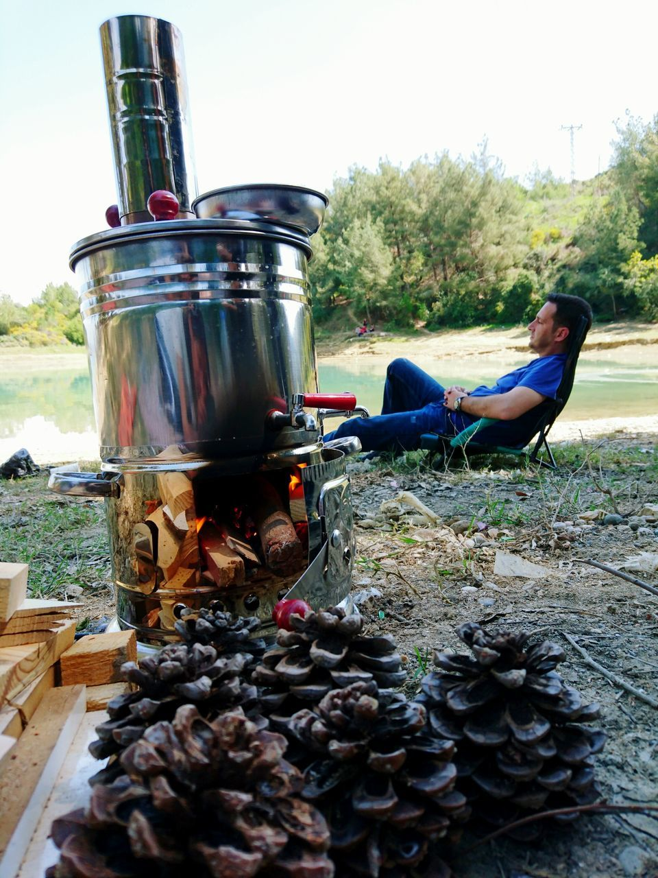 outdoors, day, food, real people, camping stove, one person, close-up