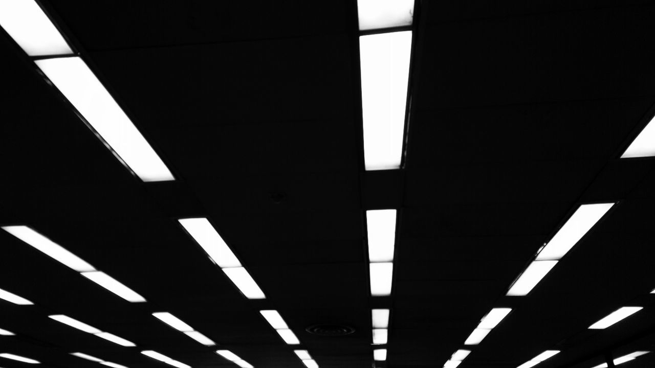 ceiling, illuminated, low angle view, indoors, no people, architecture, pattern, line, transportation, architectural design, built structure, day, parking garage
