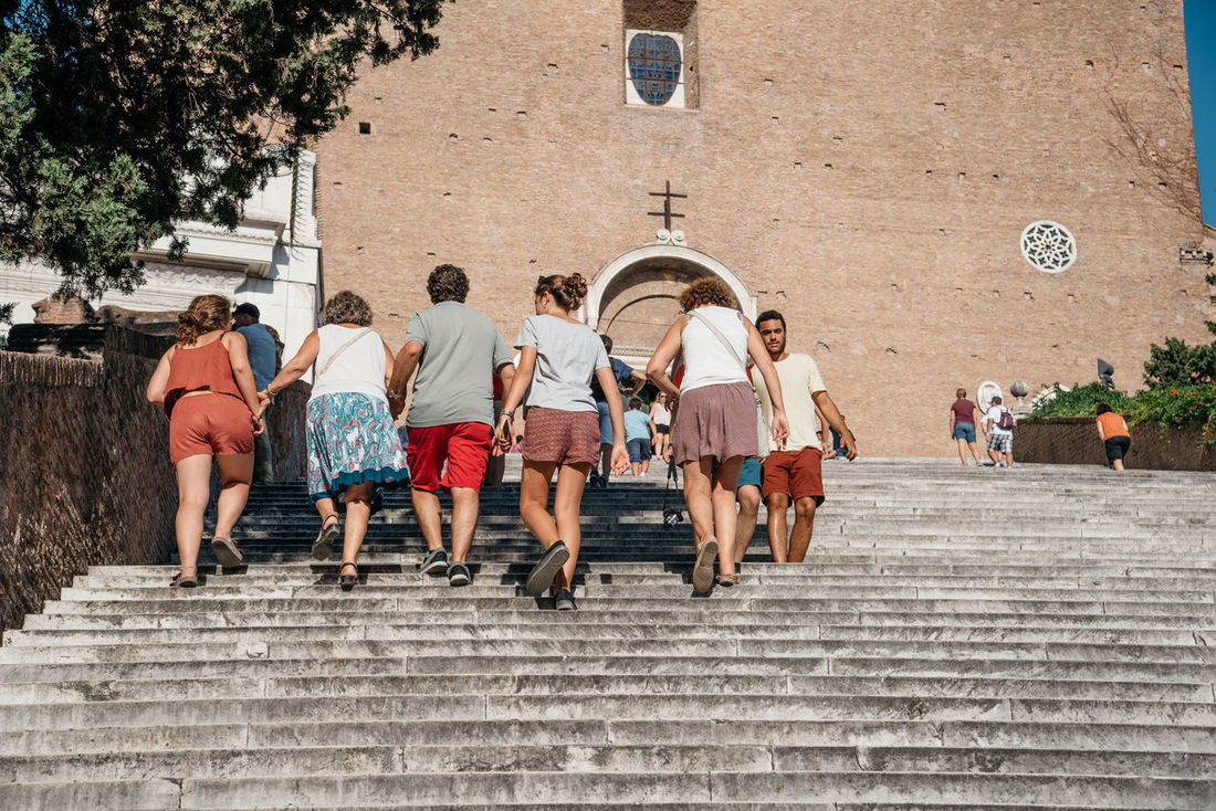 Tourists climbing Ara Coeli steps in Rome a sunny day of summer Church Tourist Tourist Attraction  Adult Adults Only Ara Coeli Architecture Building Exterior Day Large Group Of People Lifestyles Men Outdoors People Real People Roman Steps Steps And Staircases Togetherness Tree Walking Women