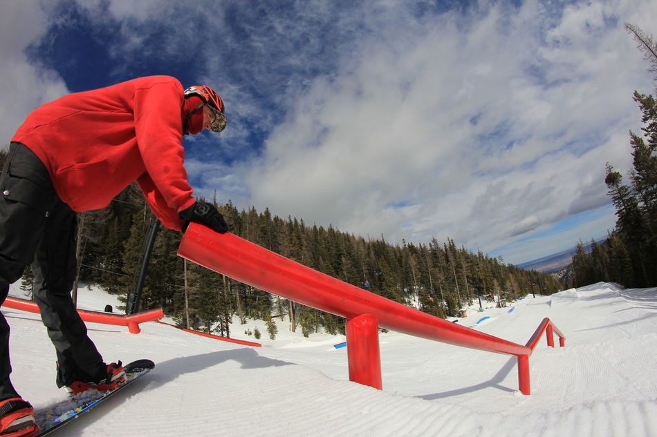 Amped Bench Cloud - Sky Courage Day Full Length Leisure Activity Lifestyles Mountain Nature Rear View Red Scenics Sitting Sky Snow Snow Covered Snowboard Snowboarder Snowboarding Terrain Park Tranquil Scene Tranquility Weather Winter Snow Sports