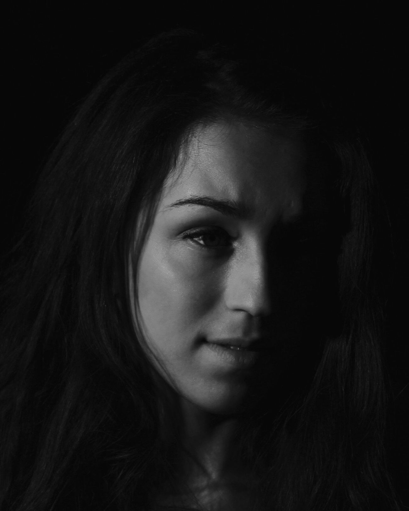 Young Adult Worried Long Hair Young Women One Person Real People Portrait Close-up Black Background Indoors  People Low Key