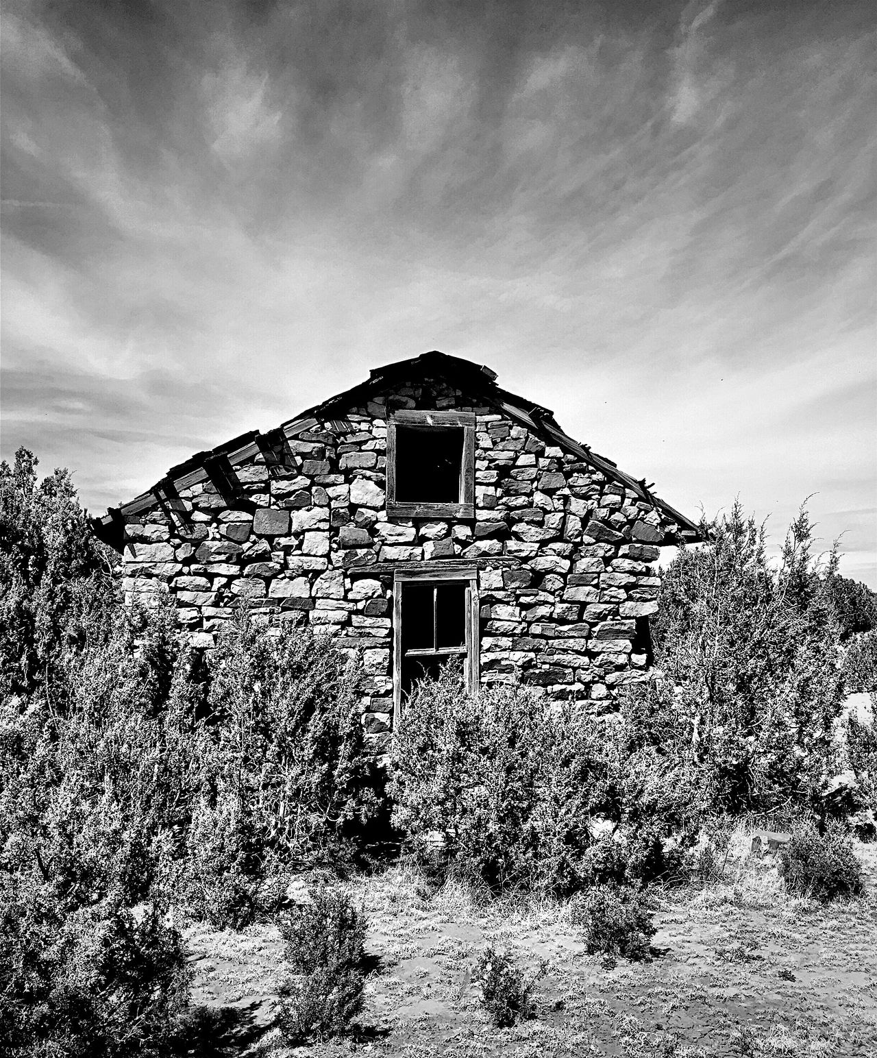 """One With Nature"" An abandoned ranch house, hand built with surrounding natural stones, sits re-assimilating in with the natural environment off State Highway 3 in rural New Mexico, USA. Stone Stonehouse Natural Beauty Newmexicophotography Old House Blackandwhite Photography Abandoned Buildings NewMexicoTRUE"