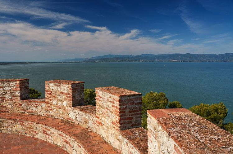 Lago Trasimeno from the Fortress of the Lion, Castiglione del Lago Italy Umbria Castiglione Del Lago Lago Trasimeno Trasimeno Lake Panorama Landscape Wall Fortress Fortress Wall Hills Water Nature Stone Built Structure No People Beauty In Nature Tranquility Travel Destinations Outdoors Scenics