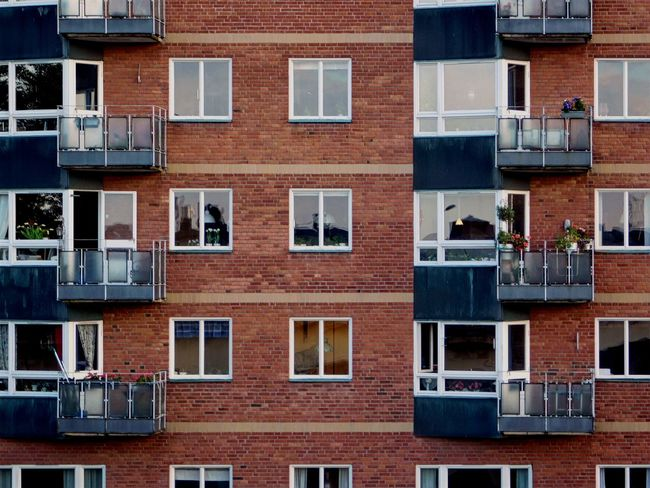 Windows. Apartment Architecture Brick Brick Building Brick Wall Bricks Building Building Exterior Building Story Built Structure City City Life Conformity Day Exterior Full Frame In A Row No People Outdoors Repetition Residential Building Residential Structure Window