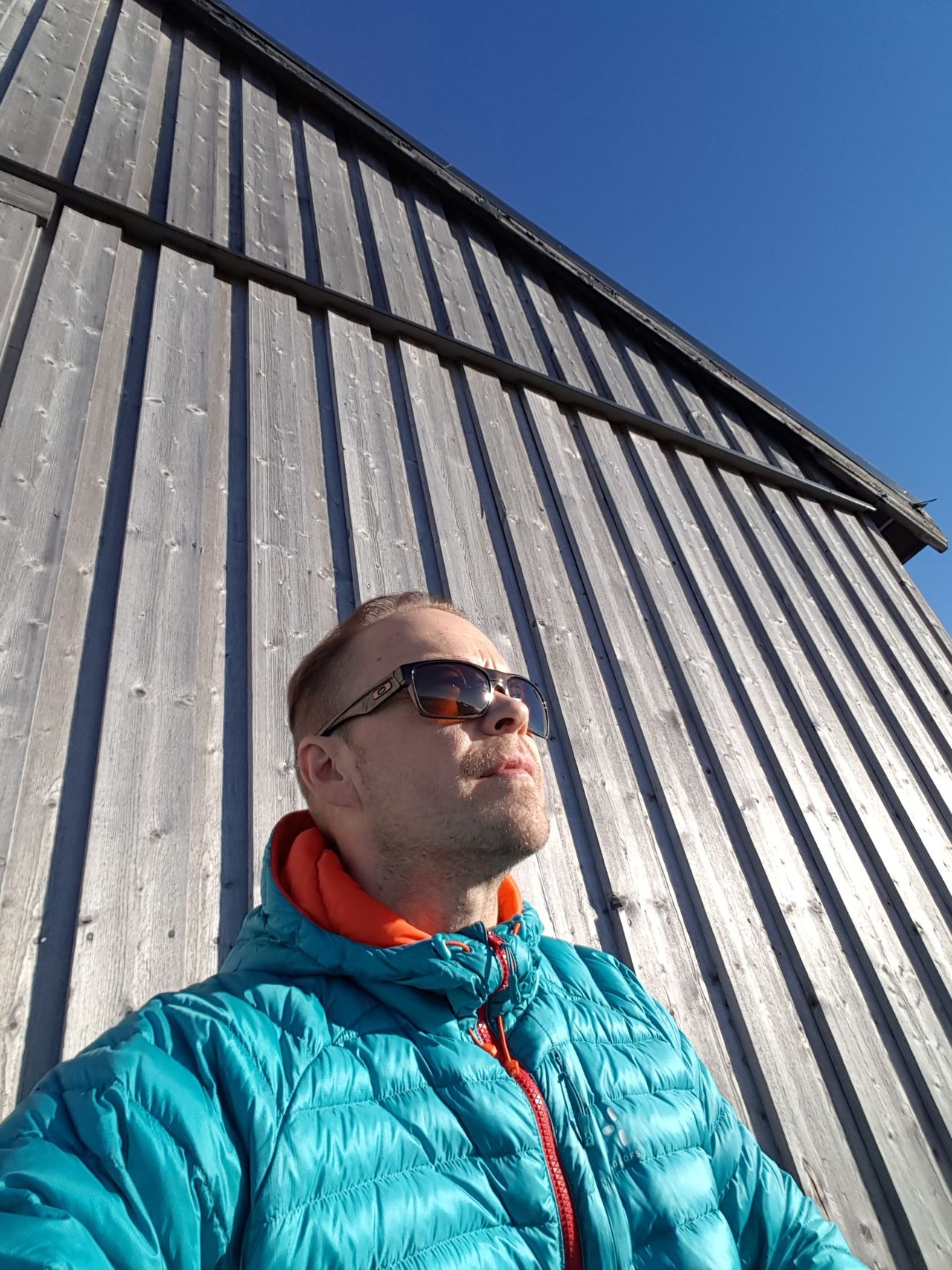 Low Angle View Young Adult Clear Sky Headshot Young Men Lifestyles Leisure Activity Architecture Person Sunny Day Blue Outdoors Kiruna Mikaeljohansson73 Non-urban Scene Sc:dynamike73 Sapmi Samsung Galaxy S7 Edge Looking At Camera Growth Grass Wide Tourism Wind Turbine