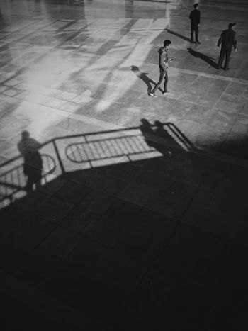 People are walking around outside of the metro plaza. Blackandwhite Black And White Monochrome People IPhoneography Plaza
