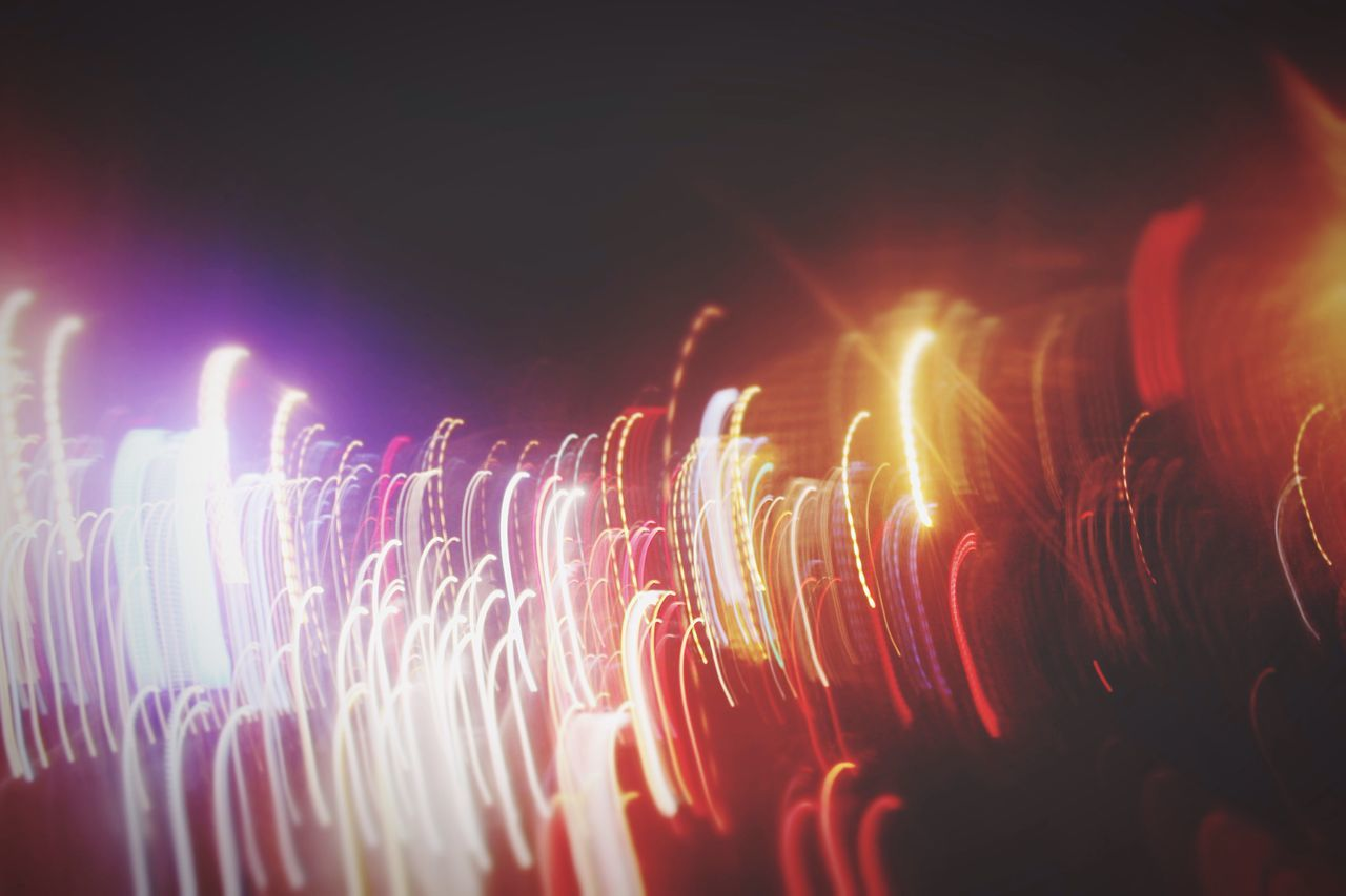 long exposure, night, glowing, illuminated, blurred motion, motion, speed, exploding, firework - man made object, arts culture and entertainment, firework display, no people, celebration, outdoors, multi colored, close-up