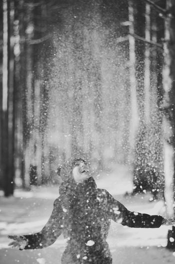 Winter luck. Girl throwing snow in the air. Beautiful Women In The World Black Black_white Blackandwhite Blackandwihte Cold Temperature Crystal Day Flakes Fun Happiness Love Luck Motion Nature One Person Outdoors Real People Smile :) Smile_winter Snow Throwing Snow White Winter Winter_smile