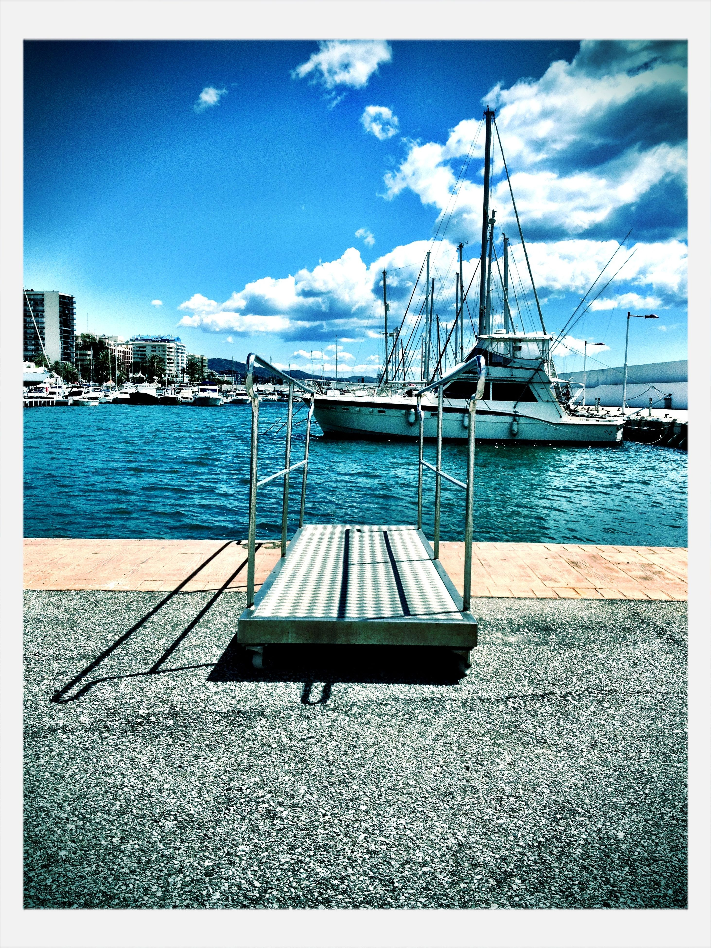 transfer print, water, sky, sea, auto post production filter, blue, nautical vessel, cloud, tranquil scene, boat, moored, transportation, tranquility, cloud - sky, pier, rippled, nature, day, built structure, scenics