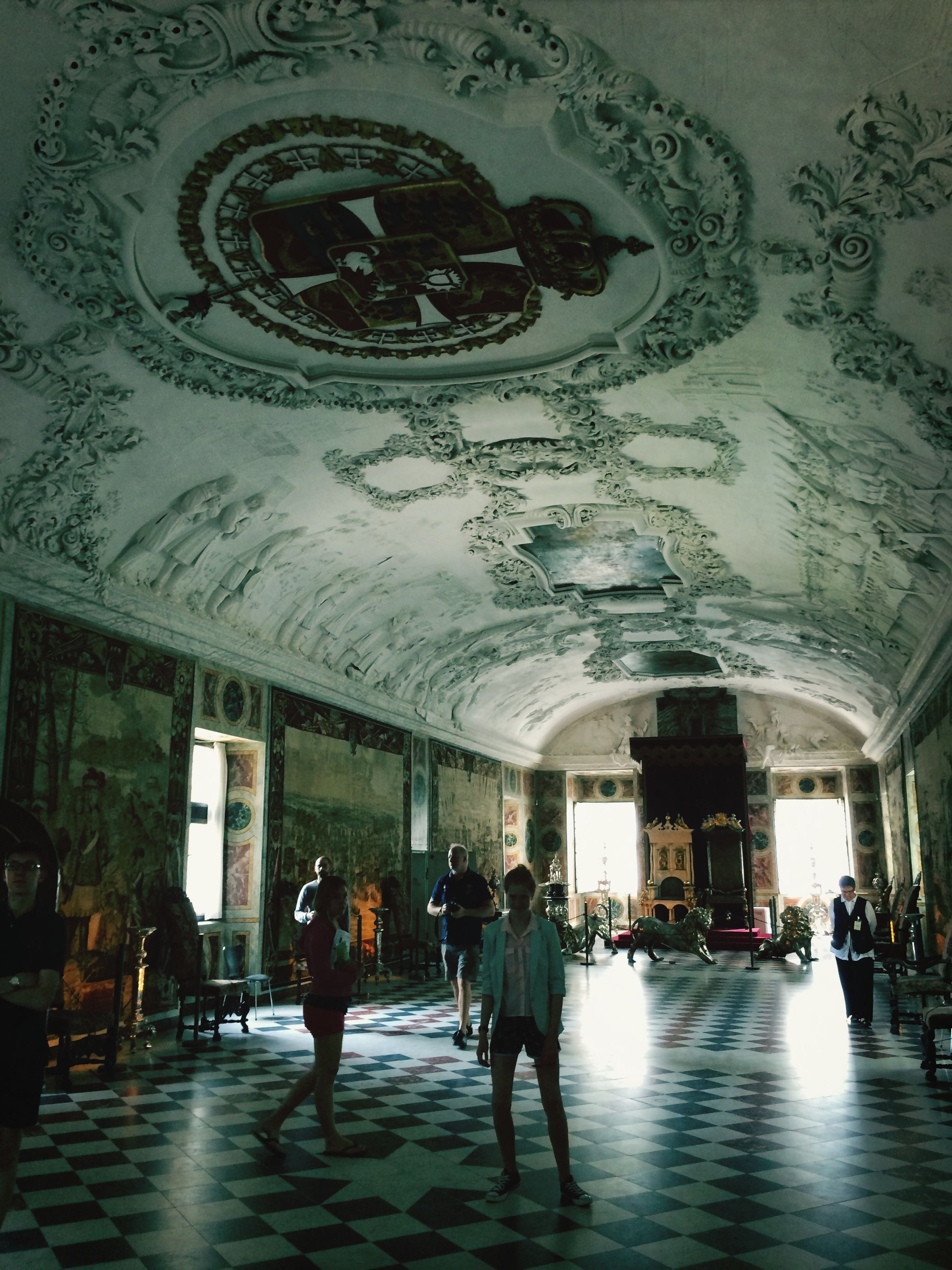 indoors, architecture, built structure, ceiling, men, lifestyles, person, walking, large group of people, illuminated, leisure activity, arch, city life, incidental people, railroad station, travel, lighting equipment, medium group of people, full length