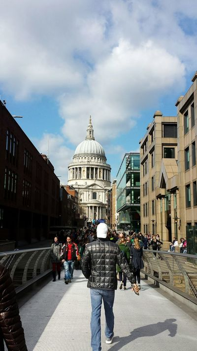 Walking along the Millenium Bridge qitha view of St Pauls Cathedral