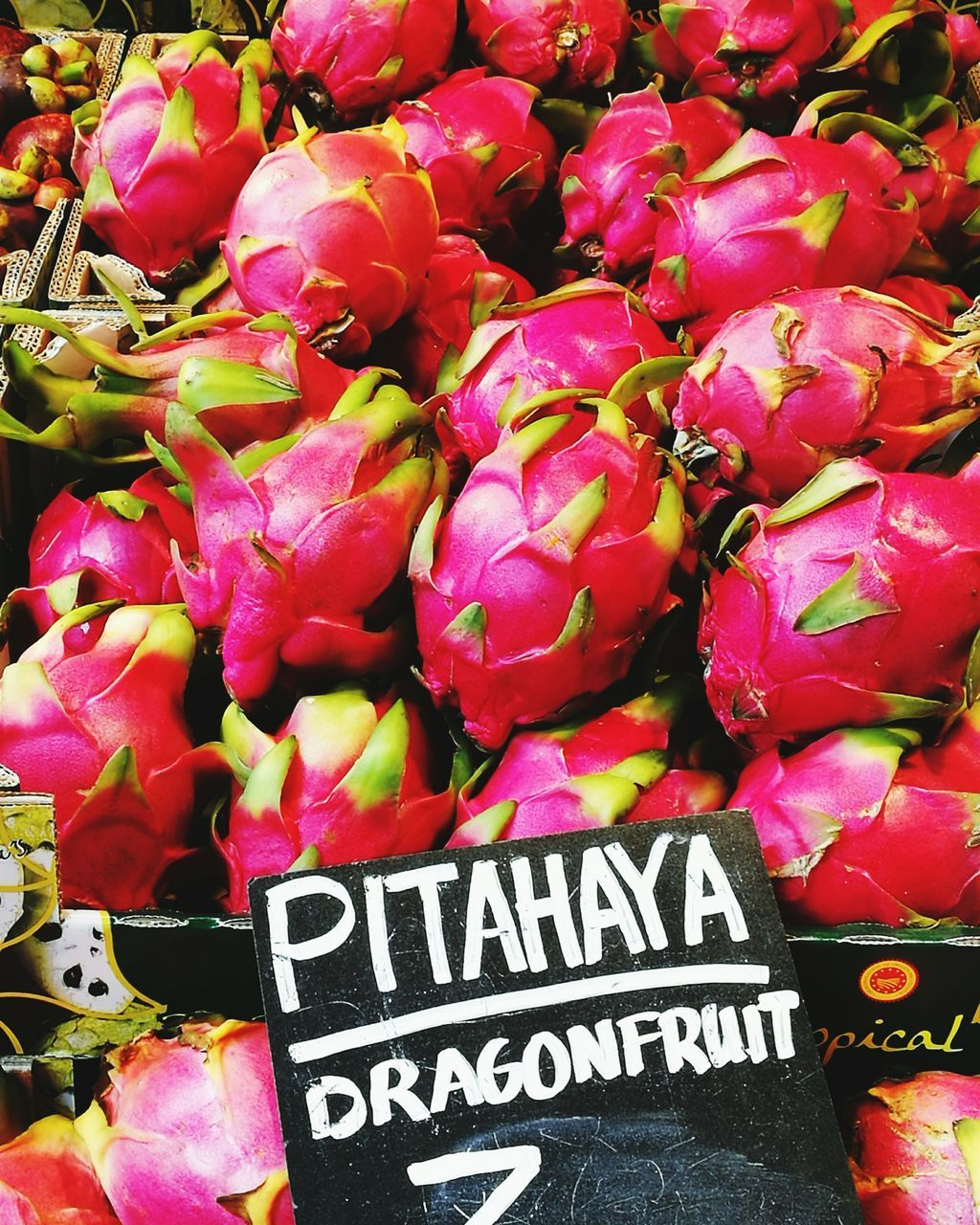 for sale, market, retail, text, market stall, freshness, abundance, vegetable, small business, no people, day, food and drink, price tag, communication, large group of objects, outdoors, healthy eating, food, variation, choice, farmer market, pitaya, close-up, nature
