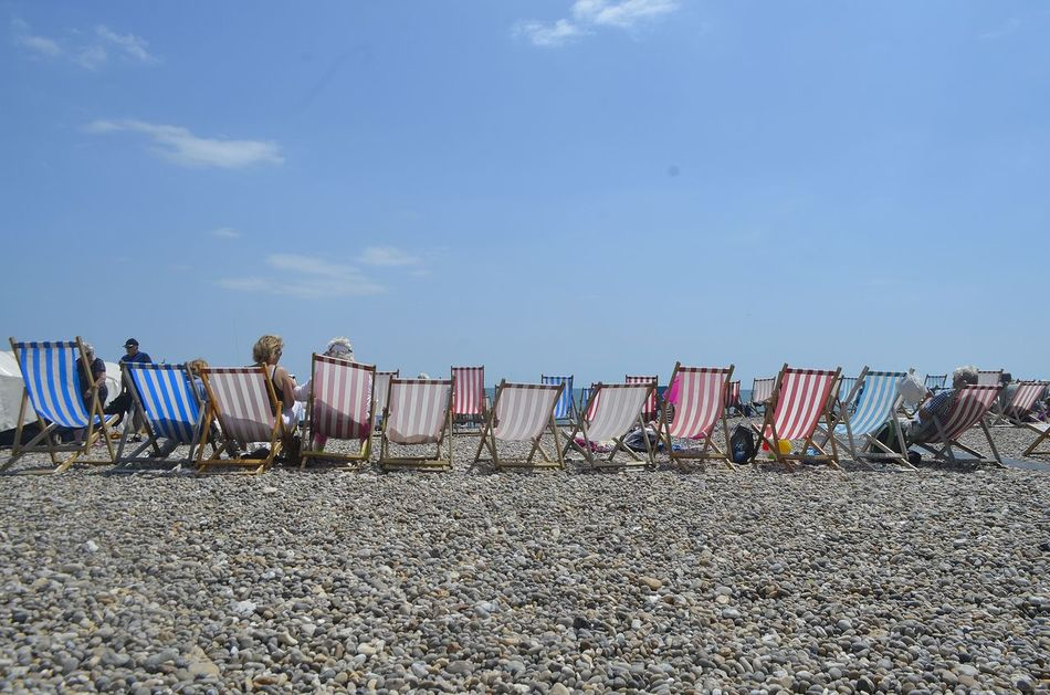 Beautiful stock photos of sunshine, Day, Deck Chair, Lifestyles, Medium Group Of People