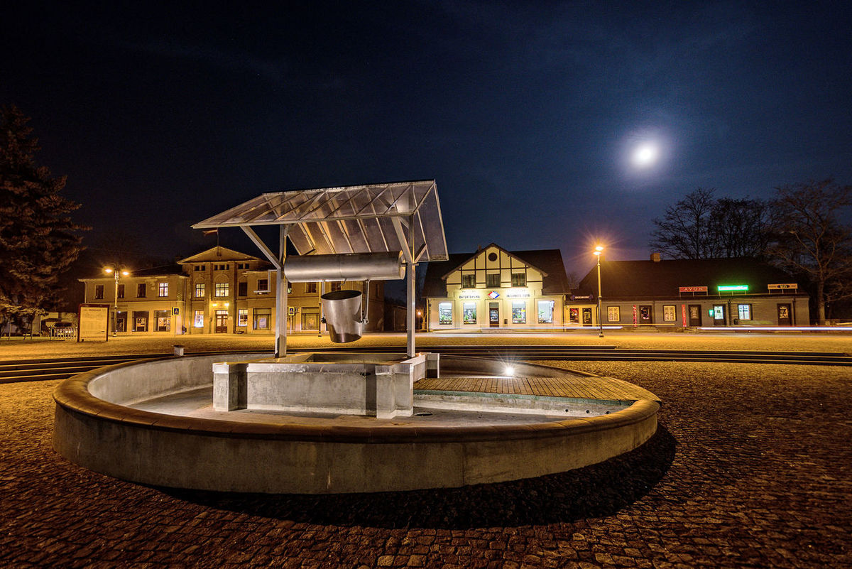 The city market square with wells at evening lights. Architecture Building Exterior Built Structure Dobele Illuminated Latvia Moon Nature Night No People Outdoors Sky The Architect - 2017 EyeEm Awards Tree Water