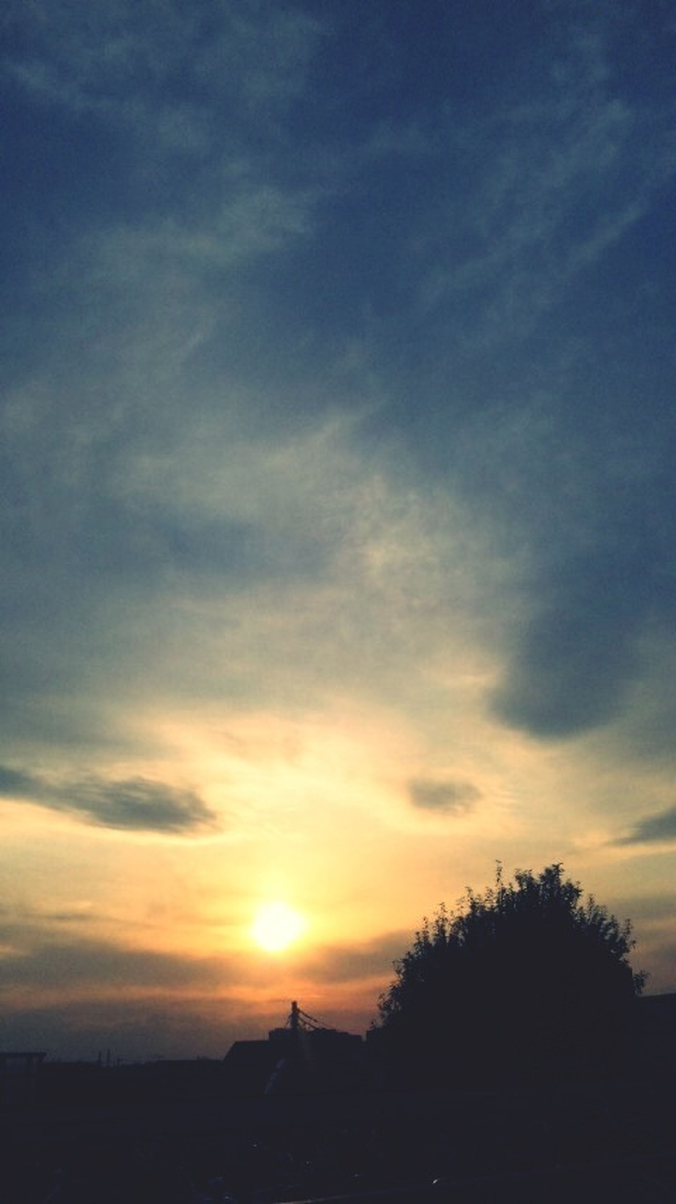 sunset, silhouette, sky, scenics, tranquil scene, beauty in nature, tranquility, cloud - sky, orange color, sun, nature, cloud, idyllic, landscape, sunlight, tree, outdoors, outline, sunbeam, dramatic sky