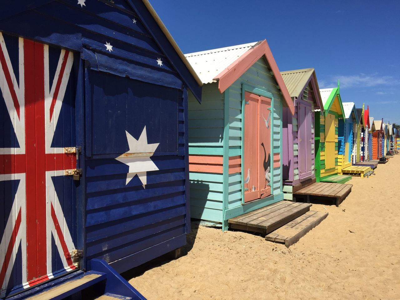A day on the beach in Australia Architecture Building Exterior Flag Sunlight No People Sand Beach Day Outdoors Patriotism Sky Beach Hut