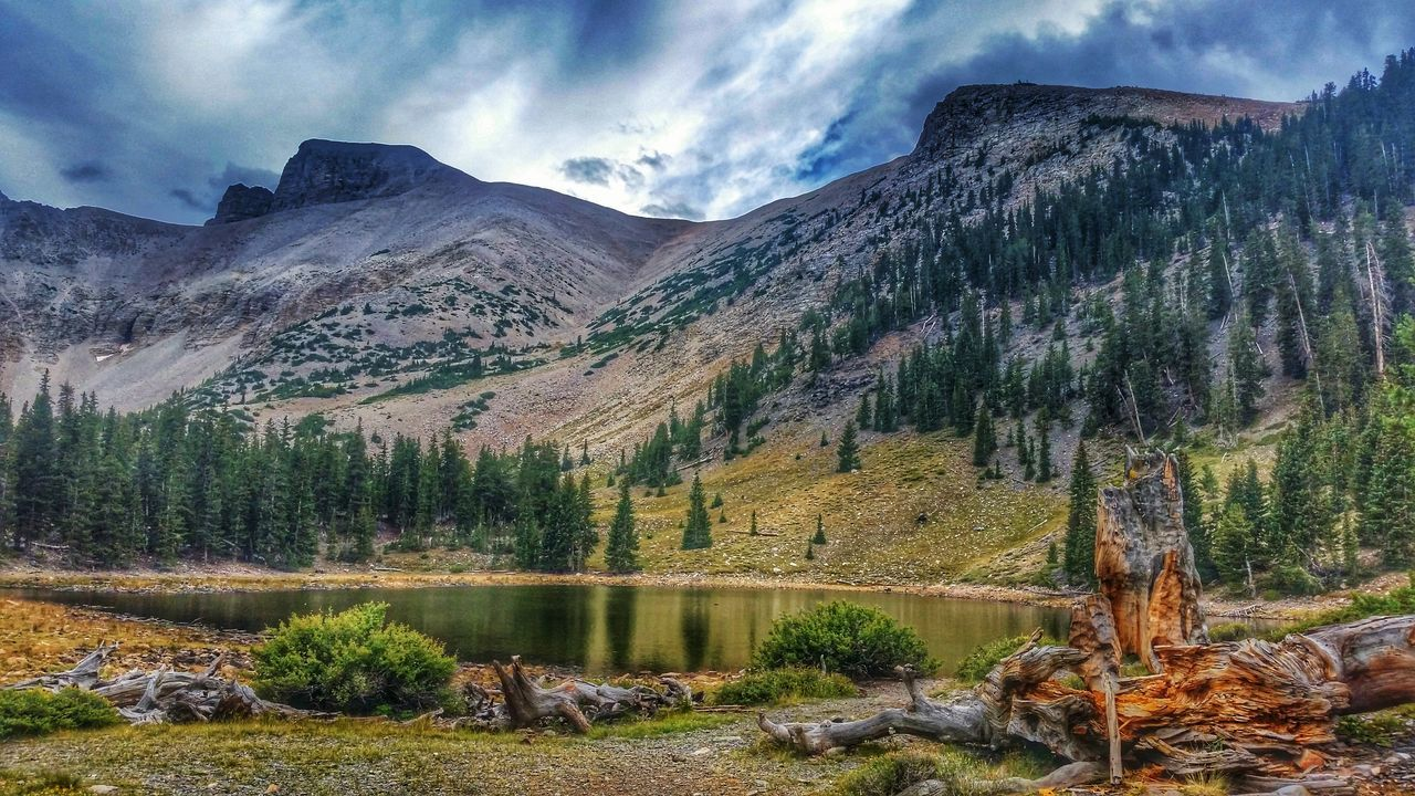 mountain, nature, tranquil scene, beauty in nature, scenics, no people, tranquility, sky, mountain range, landscape, outdoors, day, tree, water, scenery