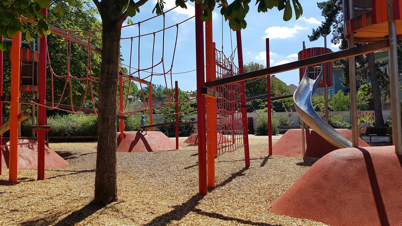 Lights And Shadows Playground Playground Equipment Playgrounds Sky Slide Tree Trees Woodchips