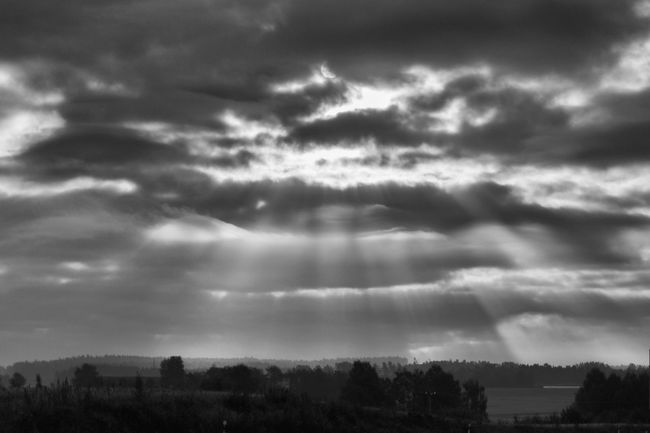 Sunlight breaks through the clouds - Black & White Black And White Blackandwhite Cloudscape Cloudy Countryside Drastic Edit Exceptional Photographs Field First Eyeem Photo Hello World Horizon Over Land Idyllic Landscape Majestic Monochrome Monochrome Photography Remote Rural Scene Scenics Solitude Sunbeam Sunlight Tranquil Scene Tranquility
