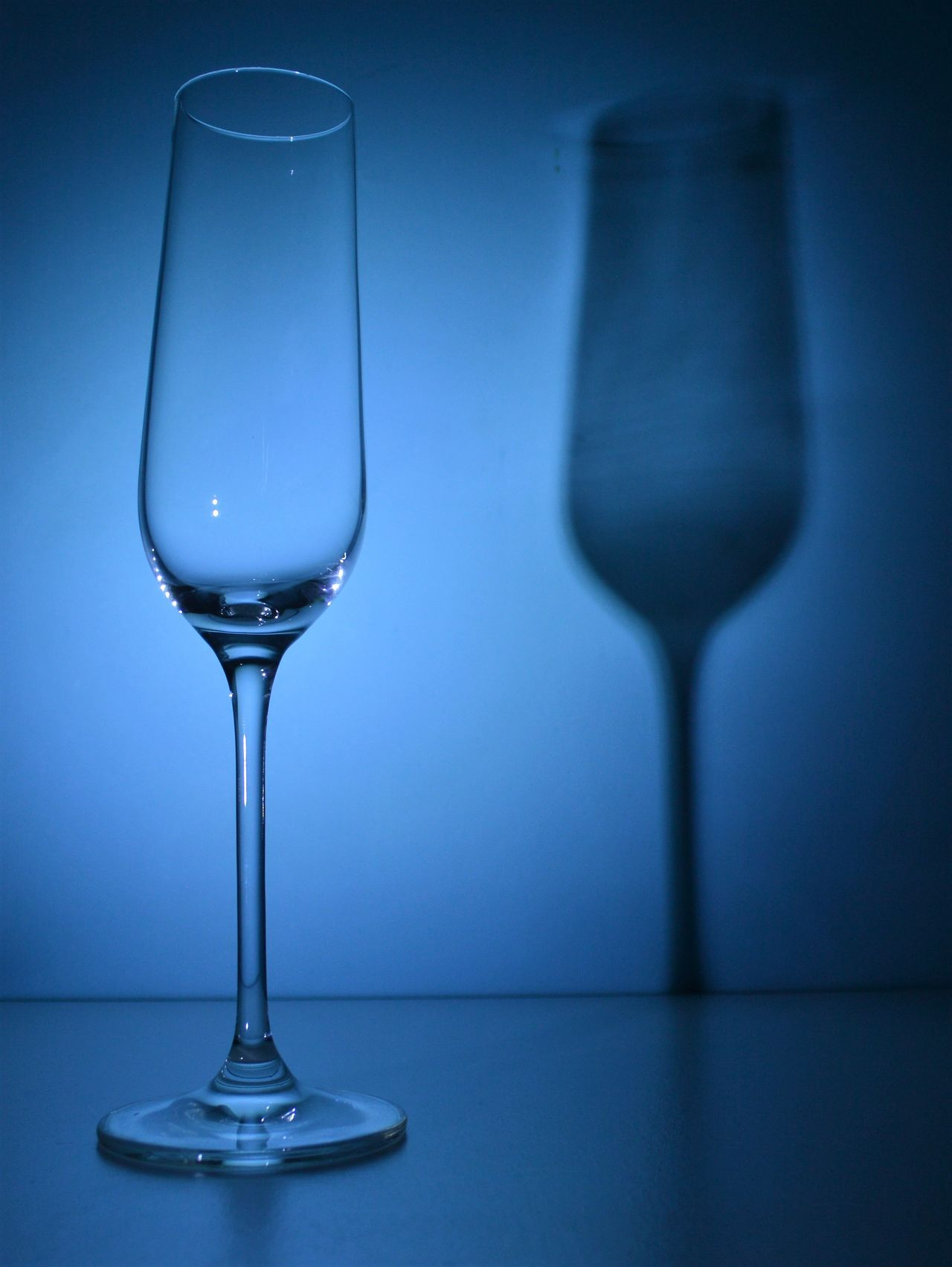First try at my photography course project on different types of lighting📸🍷 Blue Bright Lighting Drinking Glass Indoors  Photography Project Rainy Day Photography Reflection Shadow Table Wine Glass EyeEmNewHere Wine Not