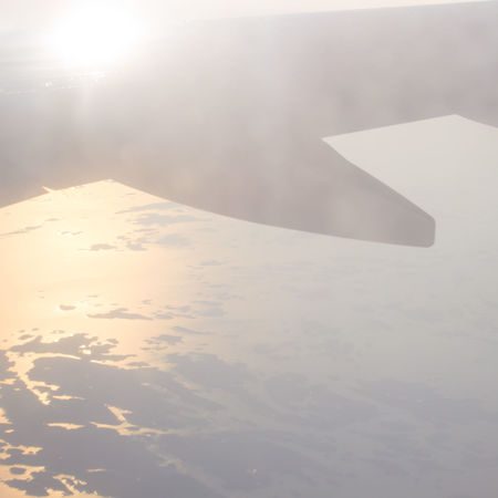 Aerial View Airplane Archipelago Blue Clouds Coast Day Finland Flying From An Airplane Window Hazy  Island In The Sun Islands Mist Orange Sky Sky And Clouds Sunset Travel Vacation View From Above Wing