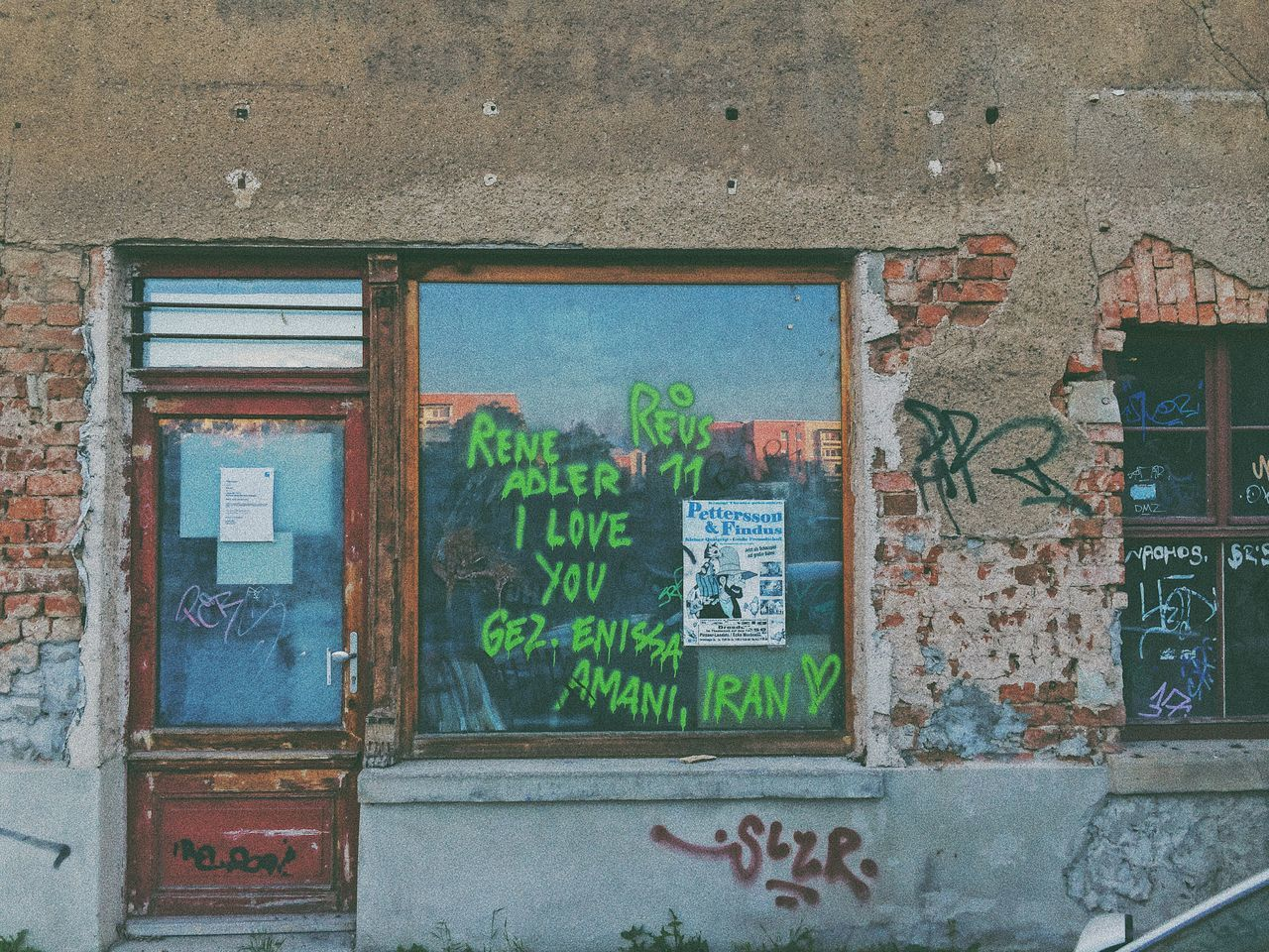 architecture, built structure, window, text, abandoned, graffiti, no people, weathered, day, building exterior, multi colored, outdoors, close-up