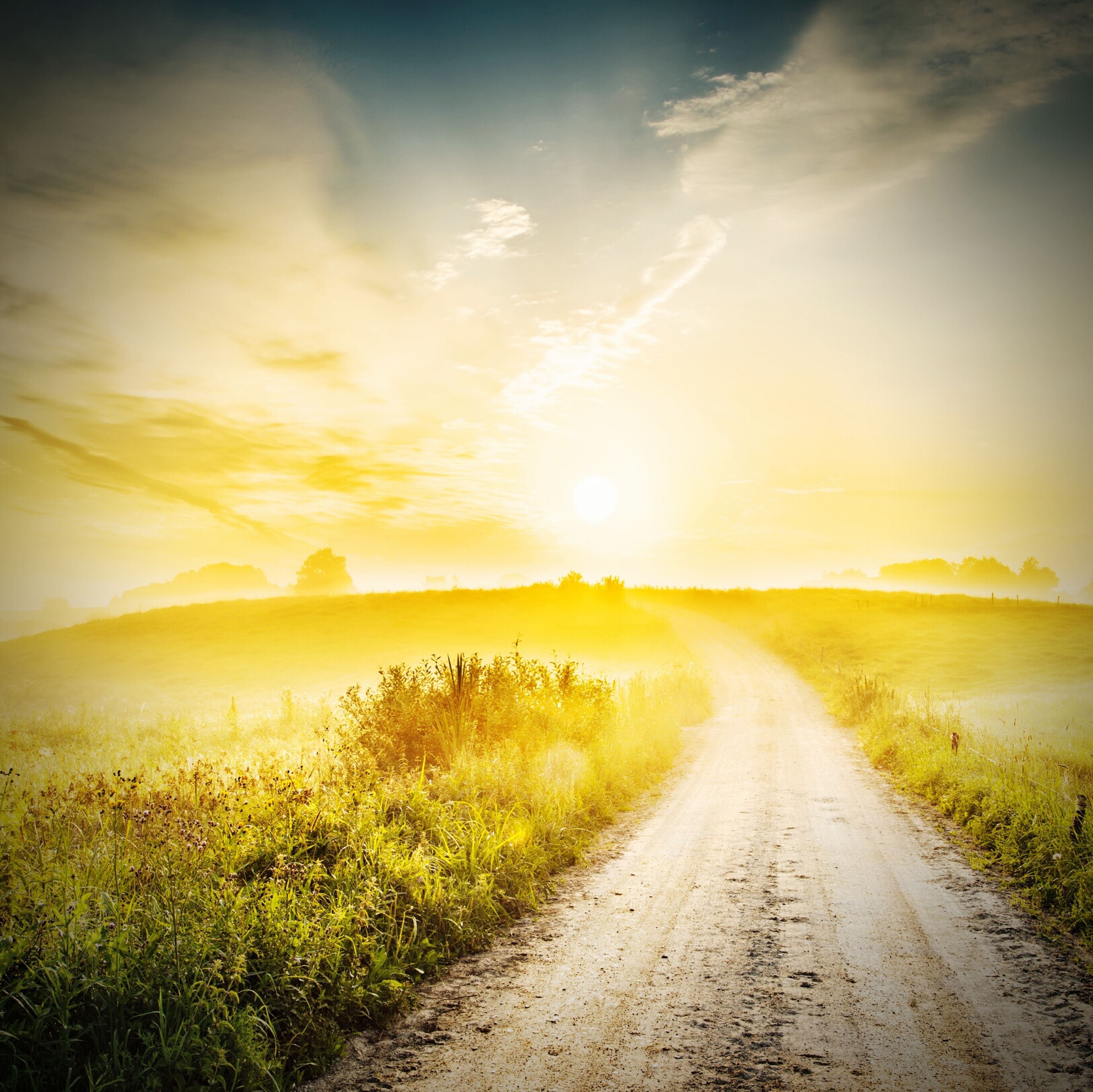 the way forward, tranquil scene, sky, tranquility, diminishing perspective, sunset, scenics, beauty in nature, vanishing point, road, grass, nature, water, dirt road, landscape, sun, field, country road, cloud - sky, idyllic