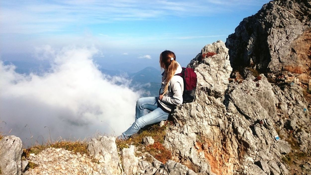 One Woman Only Leisure Activity Outdoors Mountain Day Casual Clothing Sky Nature Sitting Clouds And Sky Freedom FreeTime