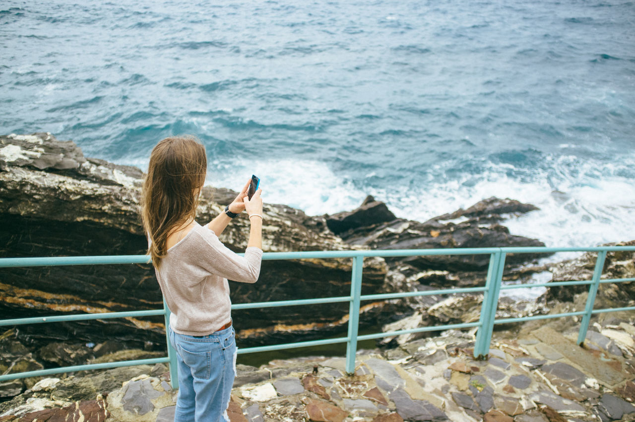 Beautiful stock photos of phone, Brown Hair, Coastline, Day, Elevated View